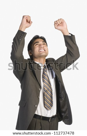 Businessman clenching fists in excitement