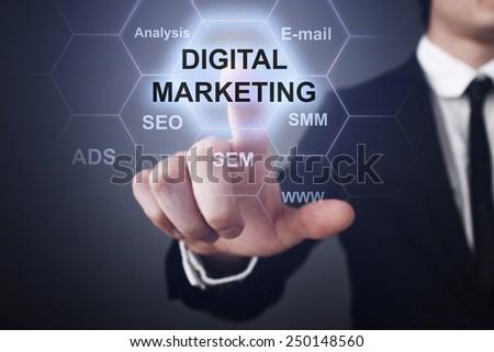 businessman clicks on virtual touchscreen display and select digital marketing concept. seo, sem, smm. - stock photo