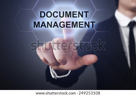 businessman clicks on virtual touchscreen display and select document management - stock photo