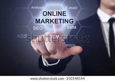 businessman clicks on virtual touchscreen display and select oline marketing concept. seo, sem, smm.