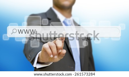 Businessman cliking on tactile interface web address bar - stock photo