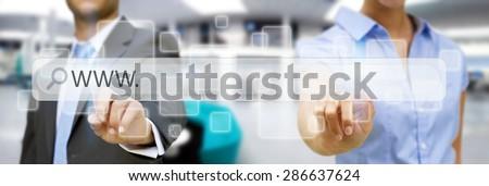 Businessman cliking on tactile interface web address bar - stock photo