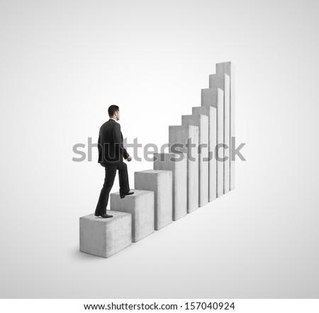 businessman climbing a graph column - stock photo