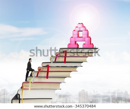 Businessman climbing books stairs toward alphabet letter A shape stack blocks, with sunny sky cityscape background. - stock photo