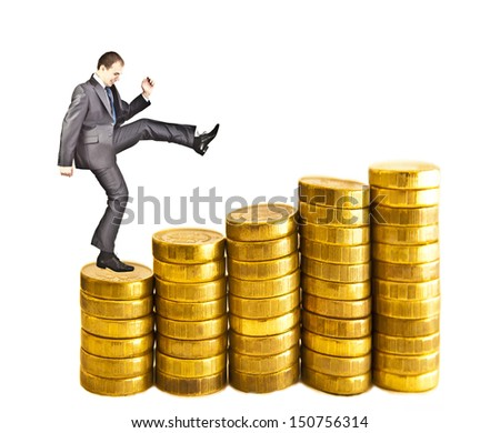 Businessman climbing gold coins stacks isolated on white background