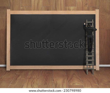 businessman climbing ladder drawing on black blank chalkboard with teak wooden wall and floor background