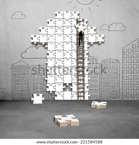 businessman climbing ladder for arrow shape puzzle on doodles wall - stock photo