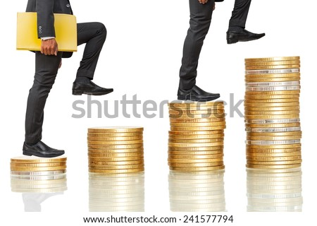 businessman climbing on coins stack to success on white background - stock photo
