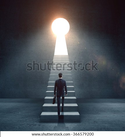 businessman climbing on concrete ledder to  open door in form keyhole - stock photo