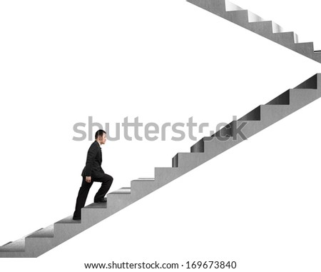 Businessman climbing on concrete stairs isolated in white background