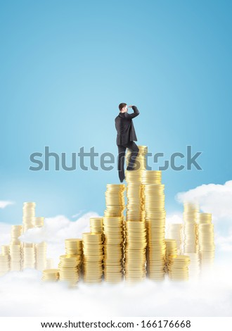 businessman climbing on gold coin city