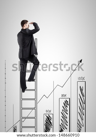 businessman climbing on ladder and looking on chart - stock photo