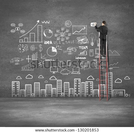 businessman climbing on ladder drawing business plan