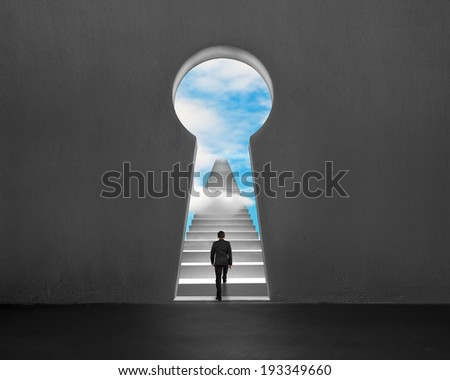 Businessman climbing on stairs with key shape hole and blue sky
