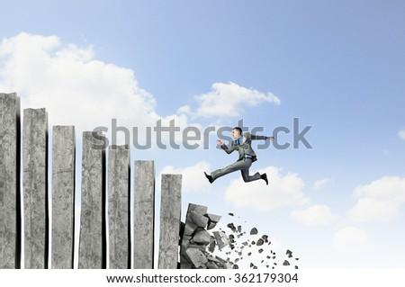 Businessman climbing stone ladder  - stock photo