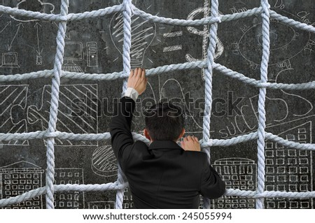 Businessman climbing the crisscross rope net on business concept doodles background - stock photo