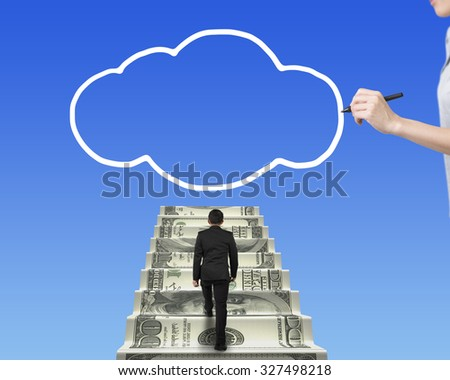 Businessman climbing the money stairs toward white cloud shape with female hand holding pen drawing, on blue sky background. - stock photo