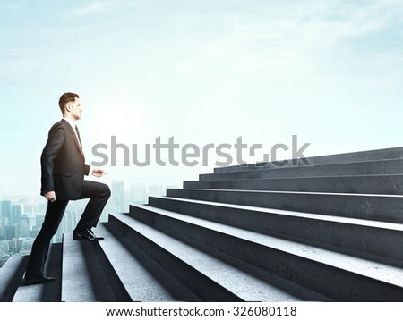 businessman climbing to stairs in cloud - stock photo