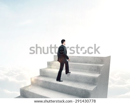 businessman climbing to stairs on cloud background - stock photo