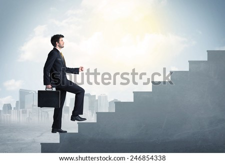 Businessman climbing up a concrete staircase concept on city background - stock photo