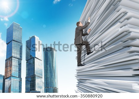 Businessman climbing up a huge stack of white paper with city background - stock photo