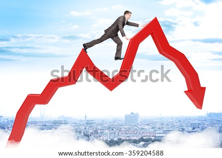 Businessman climbing up arrow - stock photo