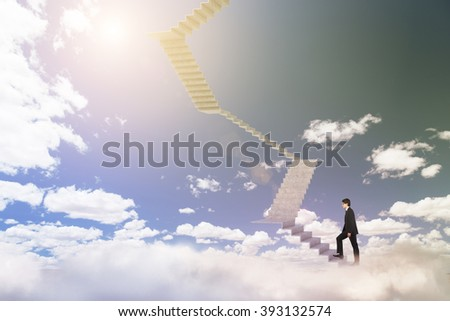 Businessman climbing upstairs, blue sky at background. Concept of career growth. - stock photo