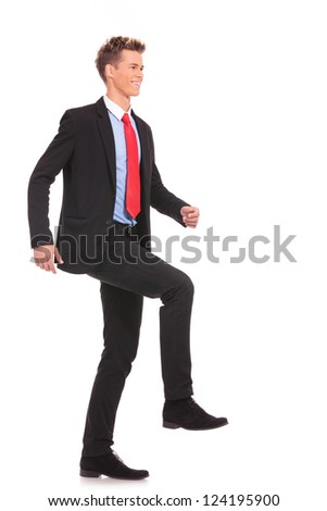 Businessman climbing virtual ladder on white background