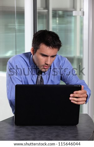 Businessman concentrating fully on laptop screen