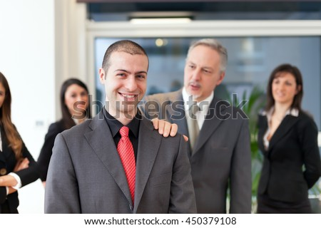 Businessman congratulating with an employee in his office - stock photo