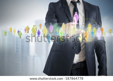 Businessman connected at futuristic social network interface - stock photo