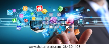Businessman connecting tech devices and cyberspace applications - stock photo
