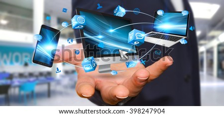 Businessman connecting tech devices computer phone and tablet