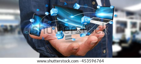 Businessman connecting tech devices computer phone and tablet '3D rendering'