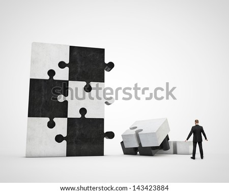 businessman constructing puzzle - stock photo