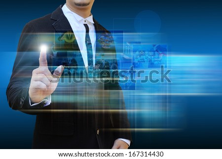 businessman contact Reaching images streaming in hands .Financial and technologies concepts - stock photo