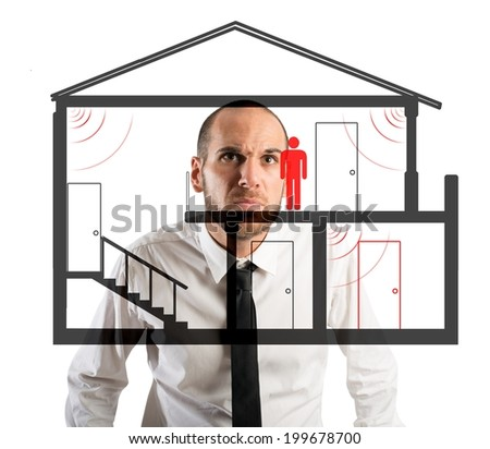 Businessman controls the thief in the house - stock photo