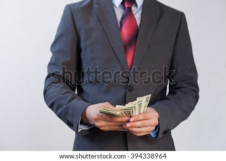 Businessman counting bill notes in white isolated