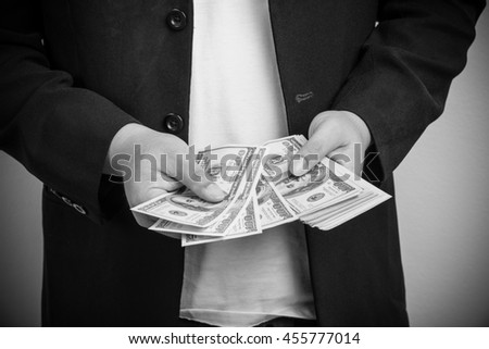 Businessman counting money american dollar. - stock photo