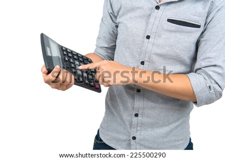 Businessman counting on calculator. - stock photo