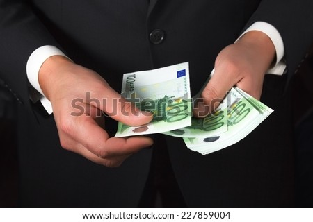 businessman counts money