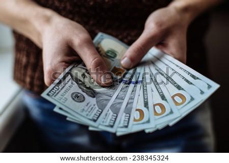 businessman counts money - stock photo