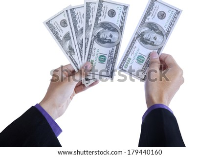 Businessman counts money in hands. isolated on white background