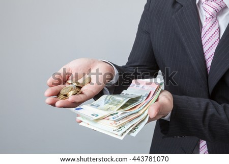 Businessman cover growing of bill or banknotes and coin euro money.