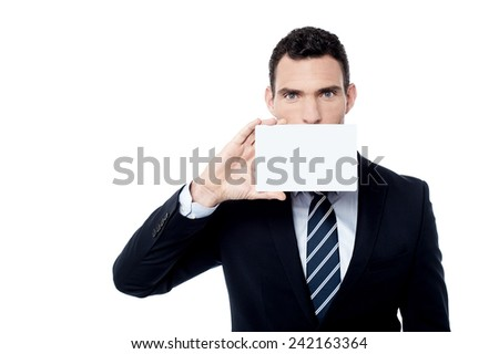 Businessman cover his face with blank card - stock photo