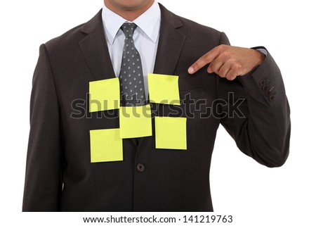 Businessman covered in blank sticky notes