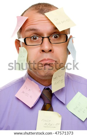 Businessman covered with sticky notes isolated on white