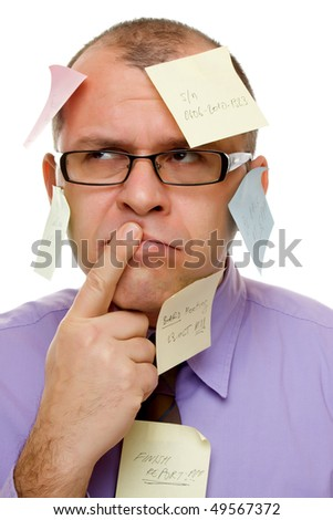 Businessman covered with sticky notes isolated on white - stock photo