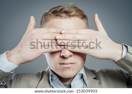Businessman Covering Eyes Isolated On Grey Background