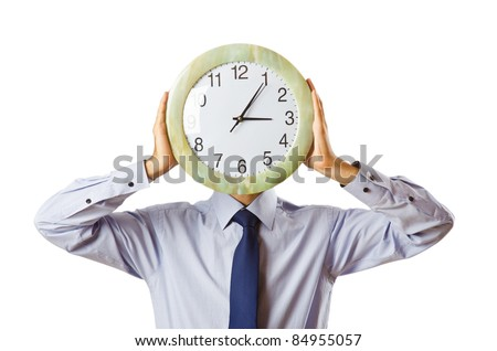 Businessman covering his face with clock